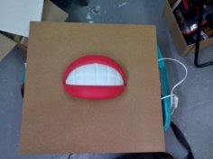 "I might make something out of this mouth-lamp: It would be a 50s-style sign that says ""Service with a Smile!"""